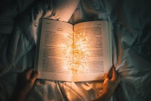 Best 5 Self improvement Books to Read to transform and change your life for 2020 - book with light
